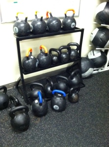 You'll need kettlebells and wall balls for this HIIT.  You can sub in dumbbells or medicine ball if needed.